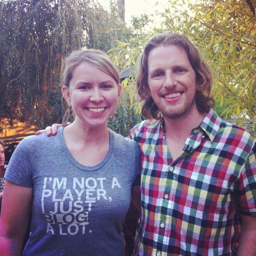 "Laura Kimball (@lamiki) wearing ""I'm not a player, I just blog a lot"" tshirt and Matthew Mullenweg (@photomatt), WordPress co-Founder"